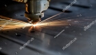 stock-photo-cutting-of-metal-sparks-fly-from-laser-318330188